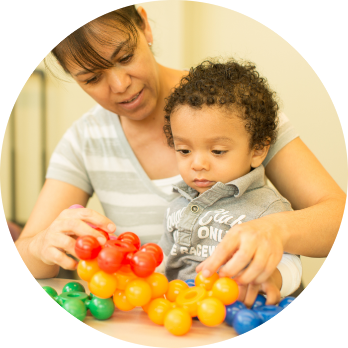 Website Circle Photo - Woman & Child with Toys
