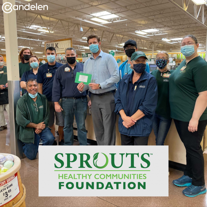 Chance Stribling, Candelen Fundraising Coordinator, accepting the grant on behalf of Candelen from Tempe Sprouts Store Manager Anthony Chambers
